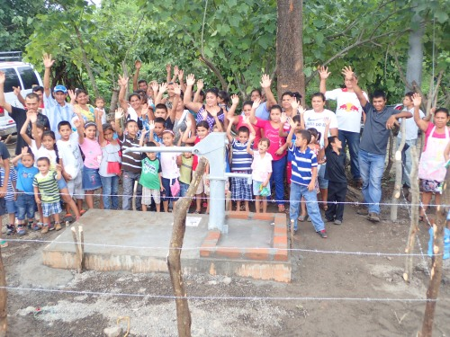 The villagers rejoiced at the dedication of the water well.